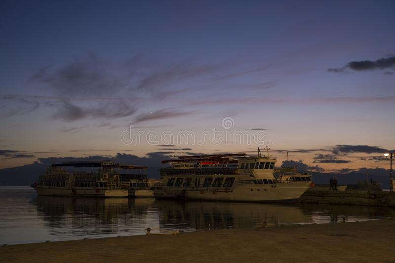 Night shot at Ohrid port with boats royalty free stock images