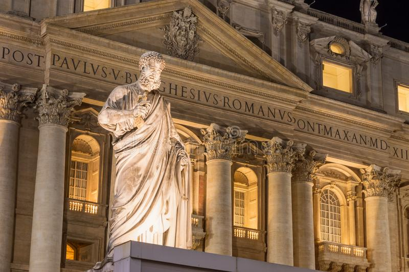 Night shot of St. Peter`s Basilica in Vatican City. Statue of Saint Peter illuminated by light in the foreground royalty free stock photos