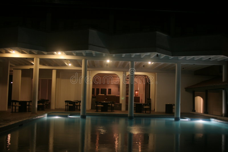 Night shot of swimming pool in stock photography