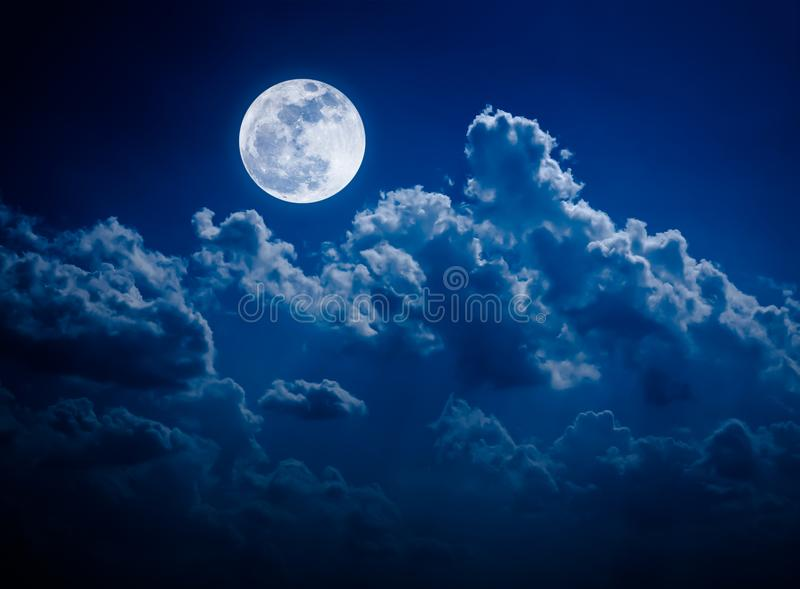 Night sky with bright full moon and cloudy, serenity nature back stock image