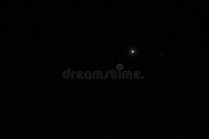Night sky with a bright planet Jupiter. A view of the open space stock images