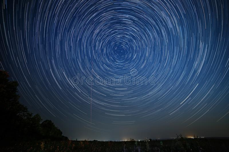 Night sky with bright stars trails. Astrophotography royalty free stock image