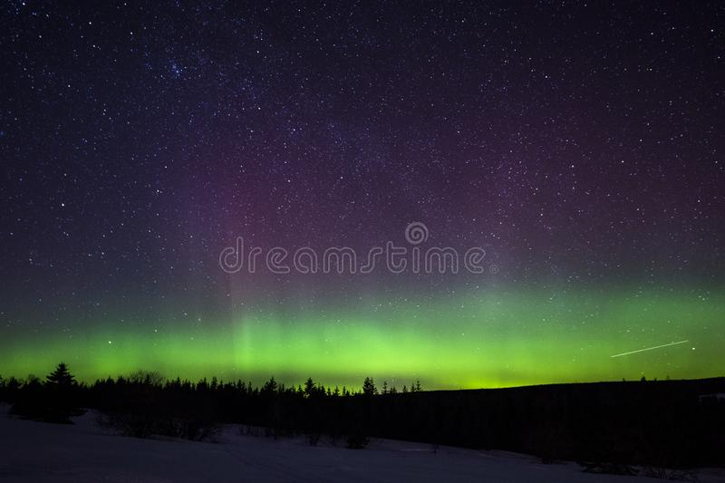 Aurora borealis in Perce Quebec stock images