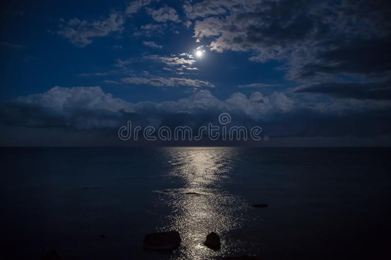 Night sky with full moon , beautiful clouds. stock photography