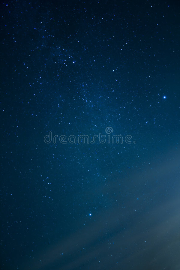 Night sky with glowing stars stock image