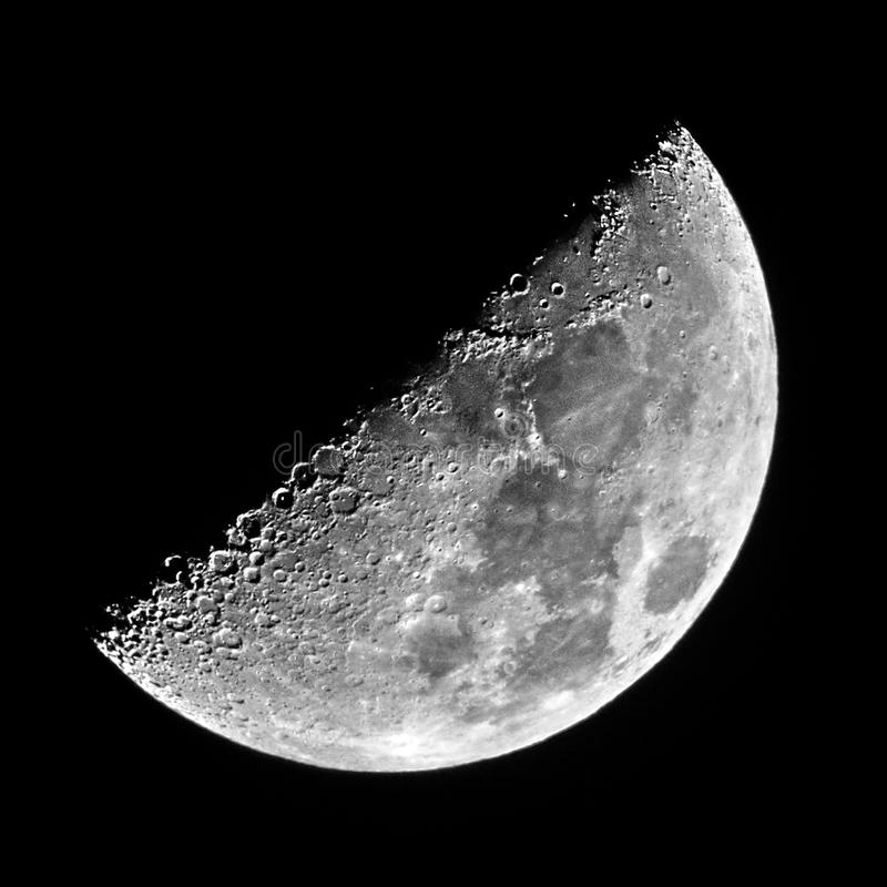 Night sky and half moon details observing over telescope royalty free stock images
