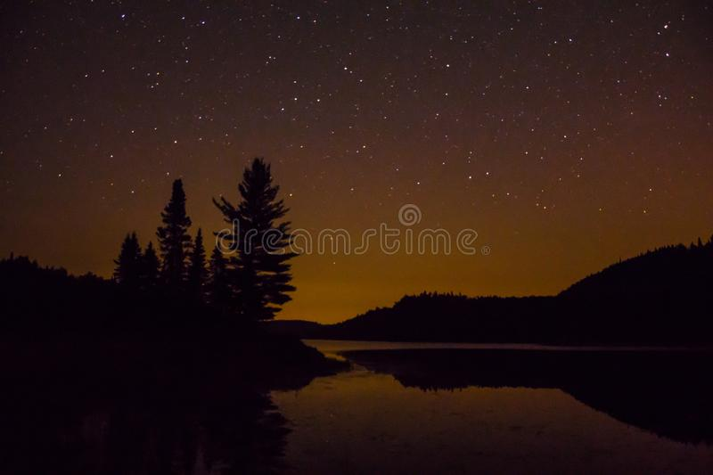 Night sky while kayak camping in Quebec.  stock photo