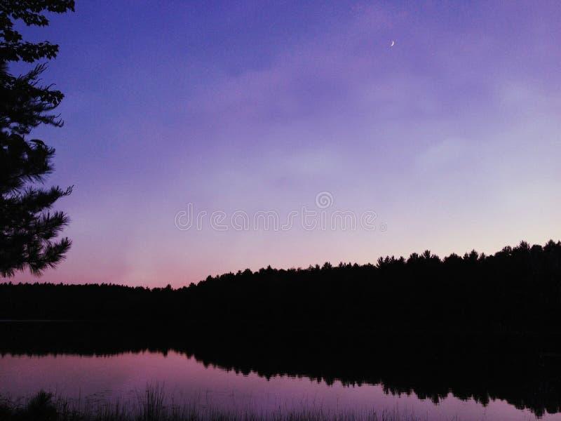 Night sky. On the lake stock photo