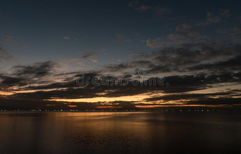 Night Sky in Manila, Philippines. Ocean Water and Cloudy Sky royalty free stock photos
