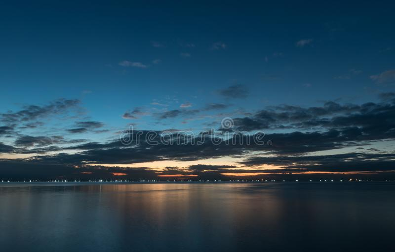 Night Sky in Manila, Philippines. Ocean Water and Cloudy Sky stock image