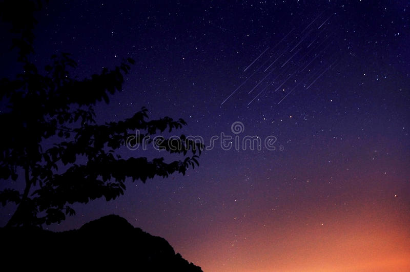 Night sky and meteors royalty free stock photography