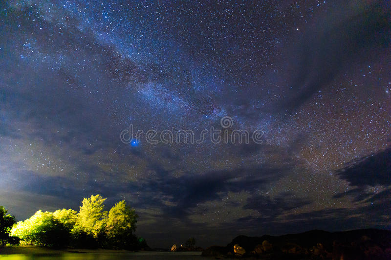 Tropical Waves Sky Mountains Clouds Island Moon Night: Night Sky Stock Images
