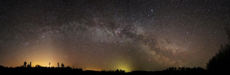 Night sky and milky way stars panorama stock photography