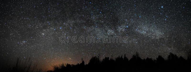 Night sky and milky way stars, Perseus Cassiopea Cygnus and Lyra constellation panorama stock photos