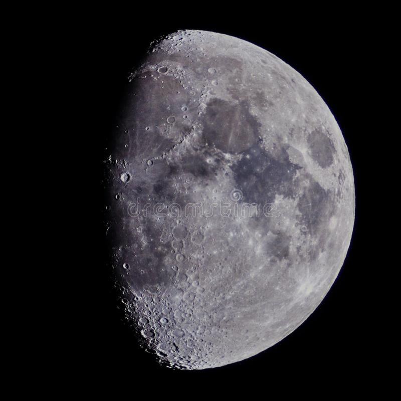 Moon on night sky over telescope royalty free stock photography