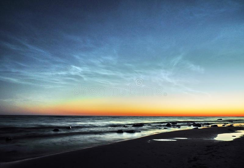 Night sky and Noctilucent clouds over sea stock images