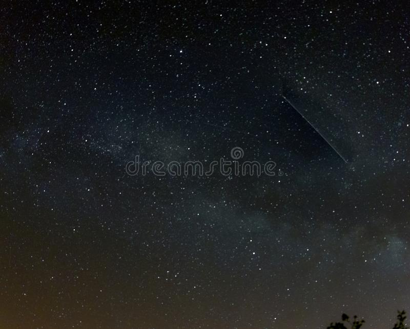 Night sky with outerspace seen from Caminha, Portugal stock image