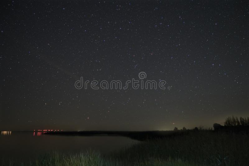 Night Sky over Fischland in Germany. Night Sky with Bodden over Fischland in Germany royalty free stock images