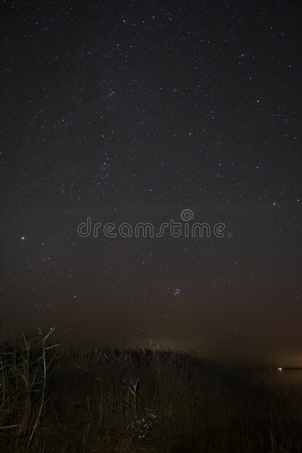 Night Sky over Fischland with Milky Way, Pleiades, An. Night Sky over Fischland in Germany with Milky Way, Pleiades, Andromeda Nebula, and Perseus Constellation stock photography