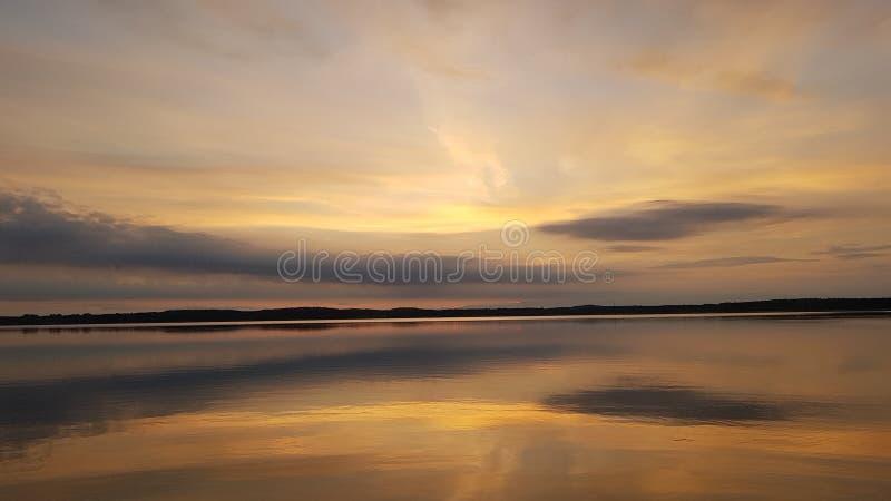 Night sky over lake stock photo