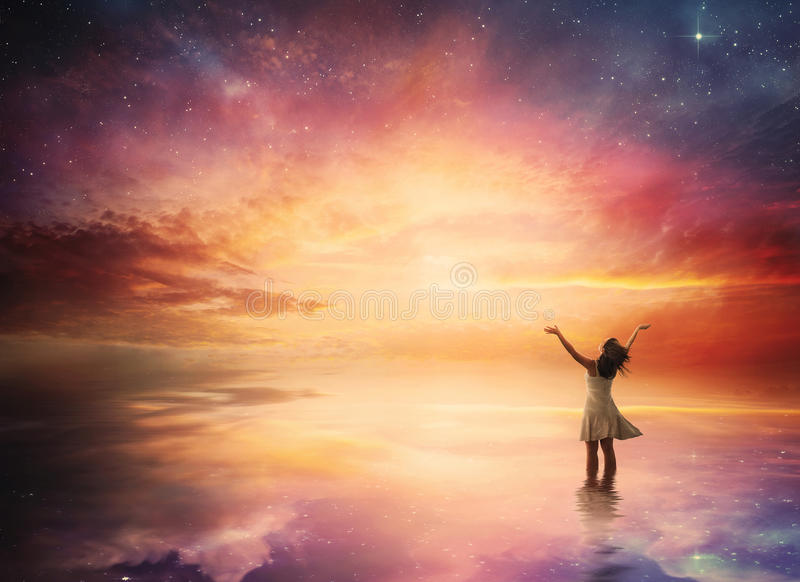 Night sky praise. Woman stands in praise before a beautiful night sky