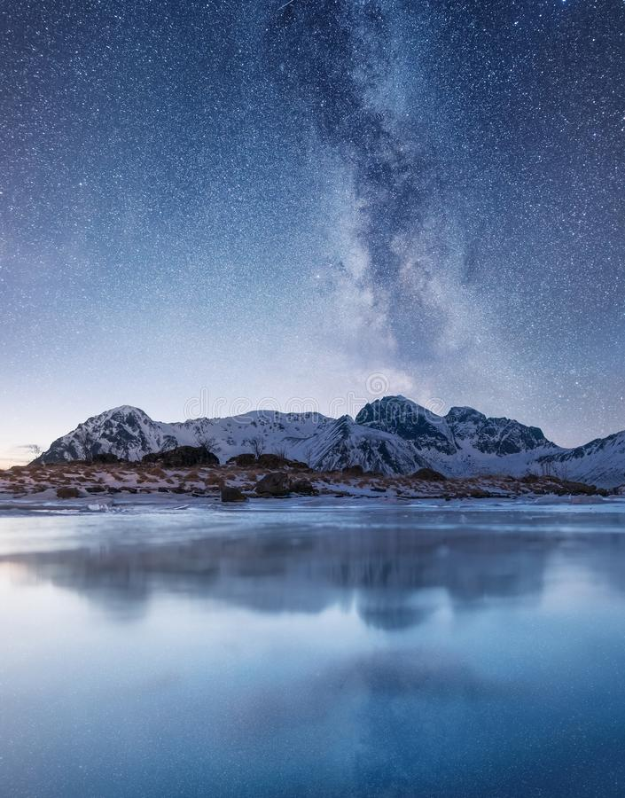Night sky and reflection on the frozen lake. royalty free stock photo