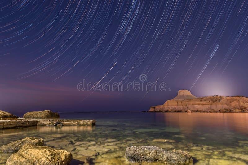 Night sky star trail stock photos