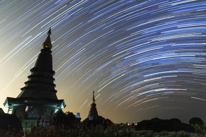 Night sky with star trail and two pagoda in Doi Inthanon mountain, natural astronomy landscape. & x28;The Great Holy Relics Pagoda named Nabhamethanidol and royalty free stock images