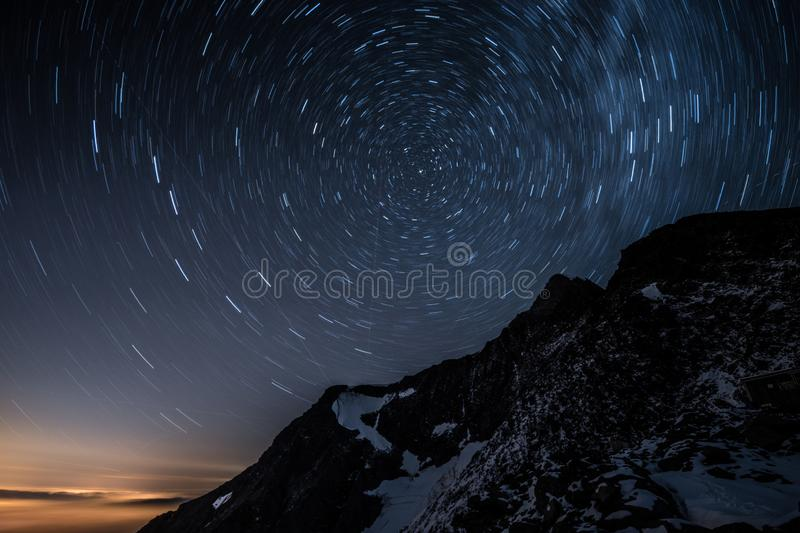 Night sky star trails above Aiguille de Bionnassay mountain, Alps, France. Night sky star motion trails above Aiguille de Bionnassay mountain, Alps, France royalty free stock image