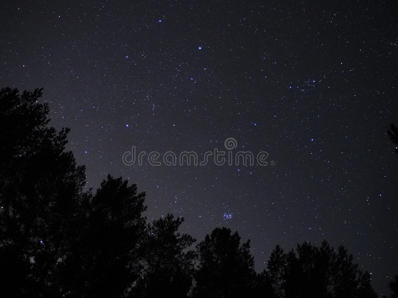 Night sky stars Auriga and Taurus constellation pleiades open star cluster. Auriga and Taurus constellation stars open star cluster Pleiades M45 on night blue royalty free stock photography