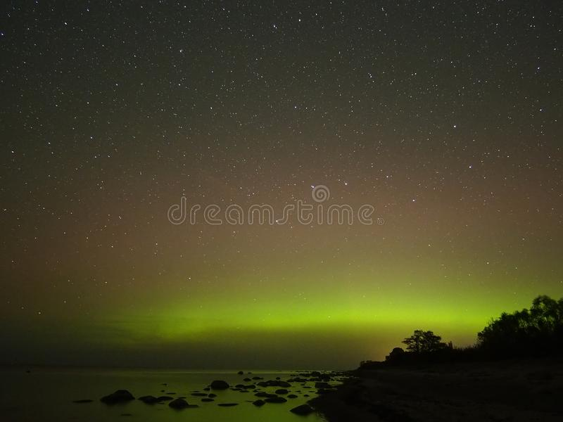 Night sky stars aurora polar lights big dipper constellation observing. Aurora polar lights observing over sea stock images