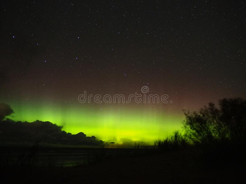 Аurora borealis polar lights and big dipper constellation stars observing stock image