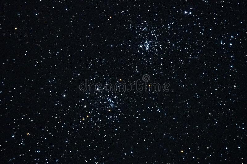 Night sky stars and double cluster observing. Night sky stars and double cluster in Perseus constellation observing over telescope royalty free stock image