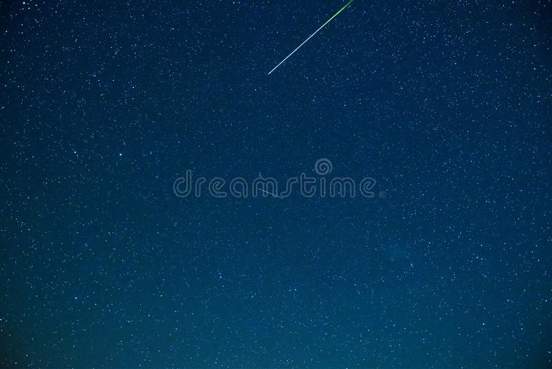 Night sky and stars with meteor or shooting star royalty free stock images