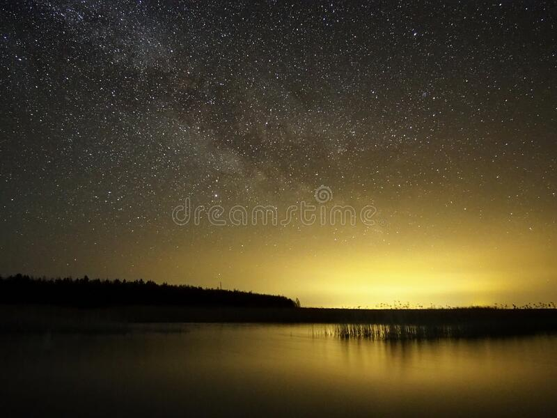 Night sky stars and  milky way over lake stock photos