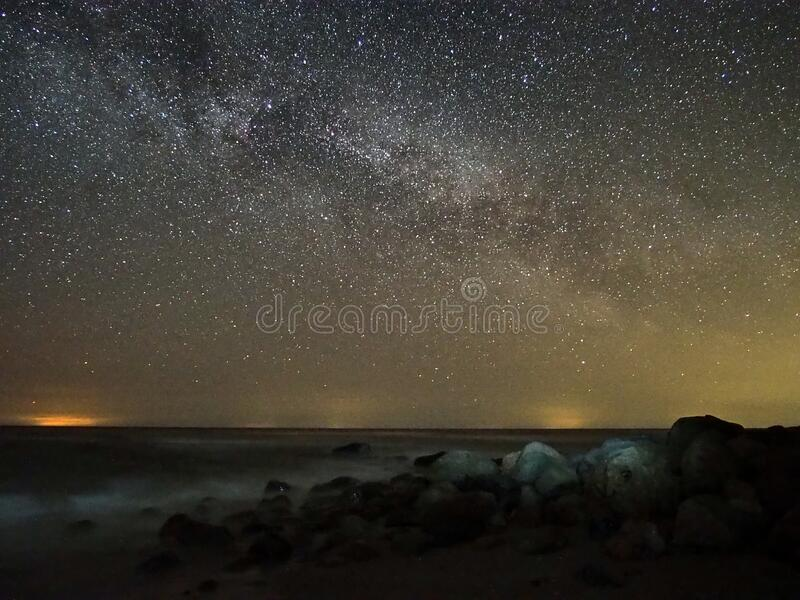 Night sky stars and  milky way over sea stock image
