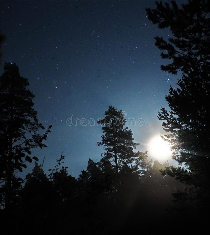 Moon light and Pleiades stars observing stock photos