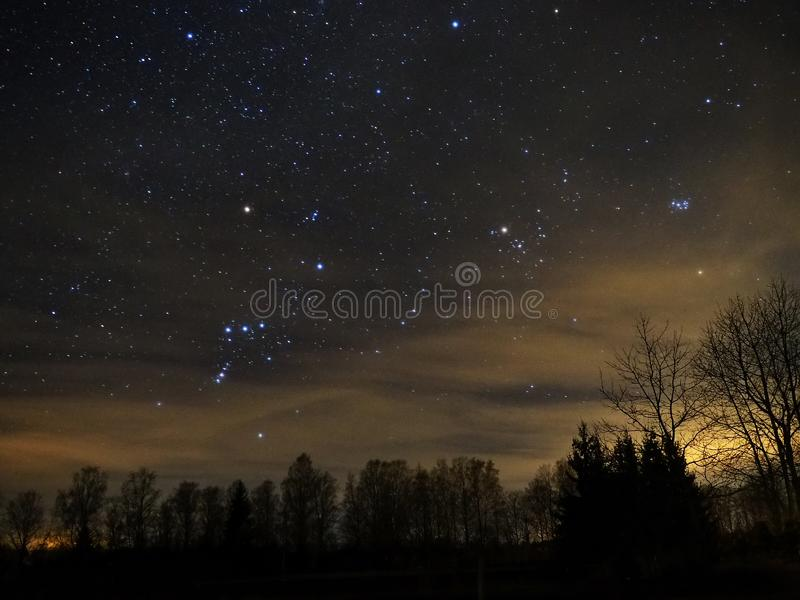 Night sky stars, Orion and Taurus constellation Pleiades Mars royalty free stock photography