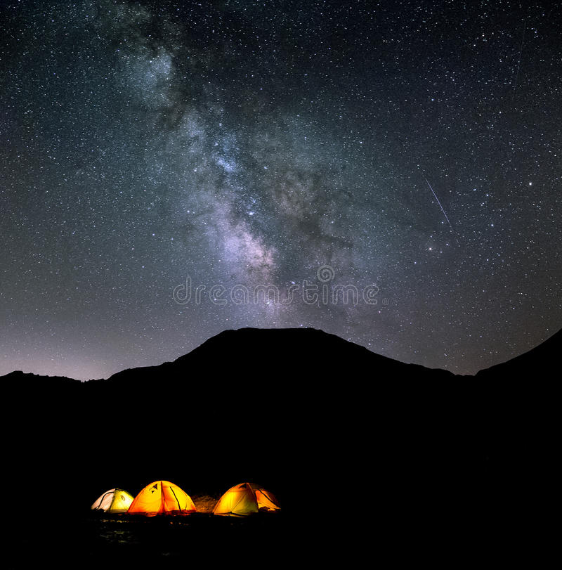 Night sky and stars over camp. Milky way and stars shining over a campsite located 3800 metres above sea level in the high altitude mountains of ALAM KUH, Iran royalty free stock images