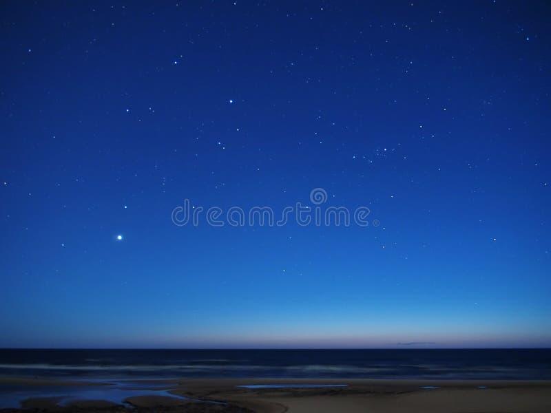 Night sky stars over sea venus auriga constellation. Night sky stars over sea nightscape royalty free stock images