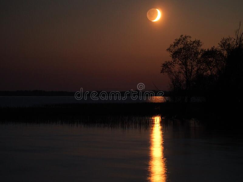 Night sky after sunset moon rising observing royalty free stock photography