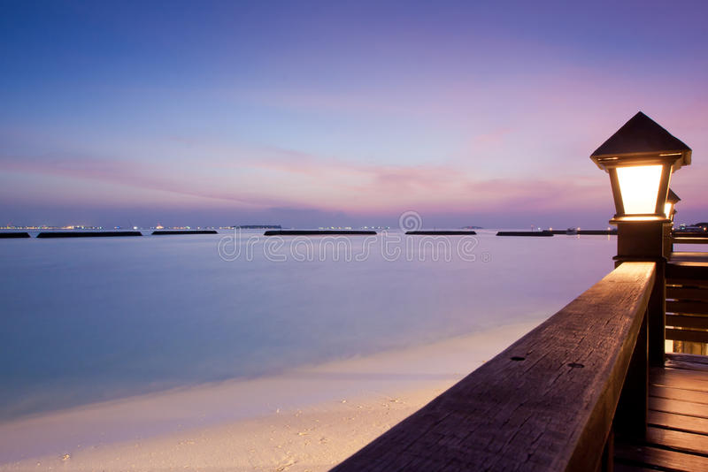 Night sky after sunset at a seaside beach resort. Night sky at a seaside beach resort with sun setting, long exposure stock image