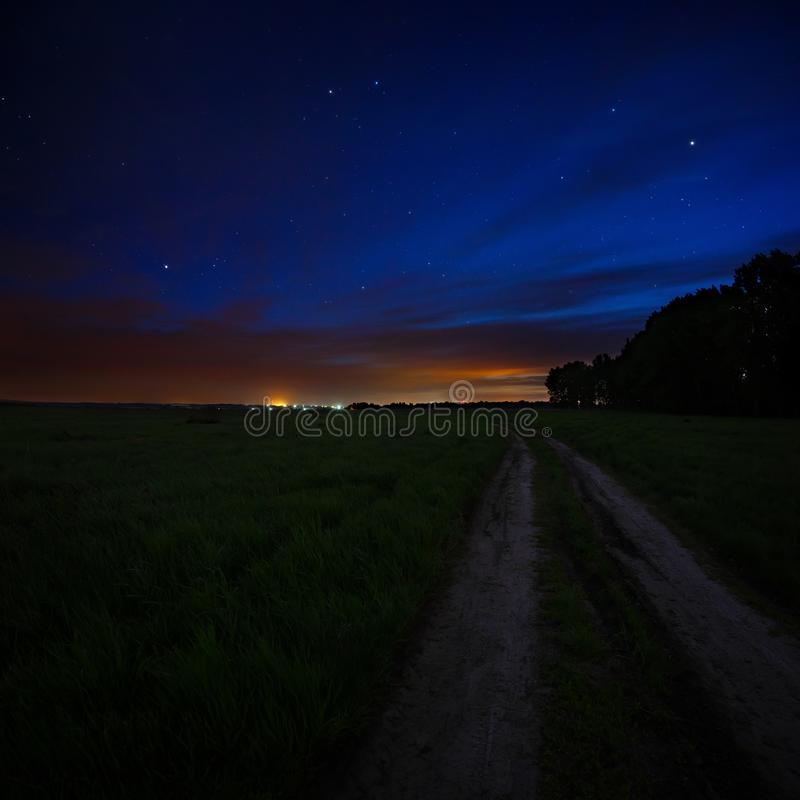 Free Night Sky With The Stars. Rural Road At Dusk. Cosmic Space Stock Photo - 117940610