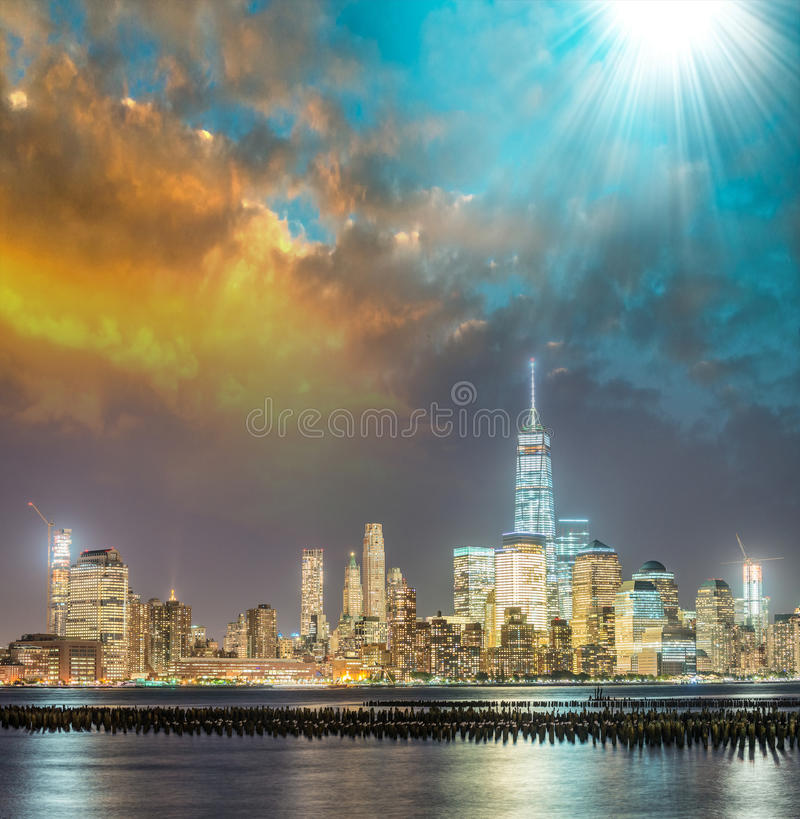 Night skyline of Manhattan at sunset, view from Jersey City coastline with Hudson reflections royalty free stock photography