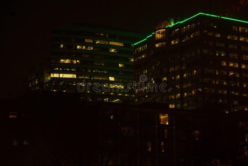 Night skyscraper close up, glowing window. Night work.Horizontal frame.  royalty free stock images