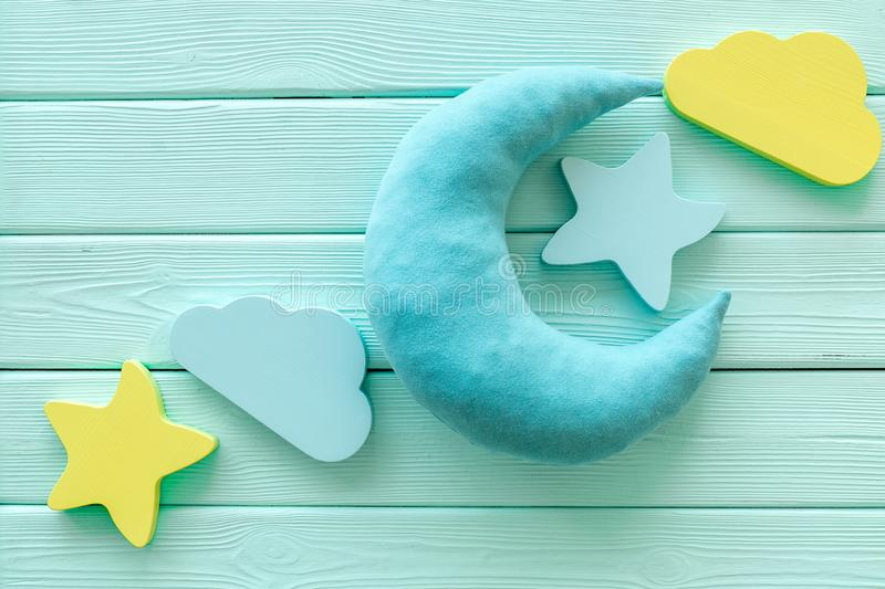 Night sleep concept with moon, stars, cloud toy on mint green wooden background top view. Good dream. Night sleep concept with moon, stars, cloud toy on mint stock images