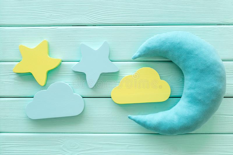 Night sleep concept with moon, stars, cloud toy on mint green wooden background top view. Good dream. Night sleep concept with moon, stars, cloud toy on mint royalty free stock photo