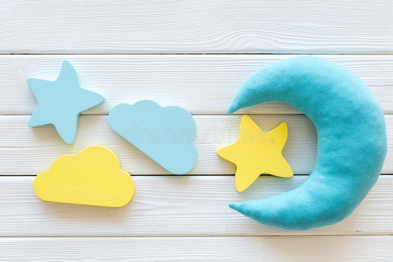 Night sleep concept with moon, stars, cloud toy on white wooden background top view. Good dream. Night sleep concept with moon, stars, cloud toy on white wooden stock photos