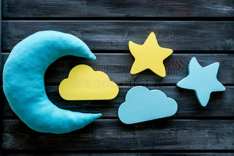 Night sleep concept with moon, stars, cloud toy on wooden background top view. Good dream. Night sleep concept with moon, stars, cloud toy on wooden background stock photo