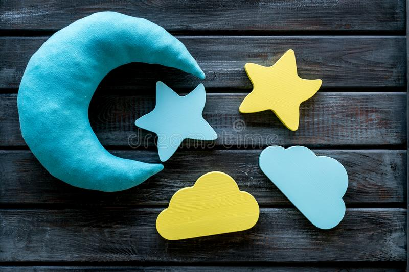 Night sleep concept with moon, stars, cloud toy on wooden background top view. Good dream. Night sleep concept with moon, stars, cloud toy on wooden background royalty free stock photos